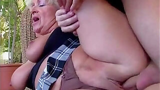6:00: Big titted mom takes young cock