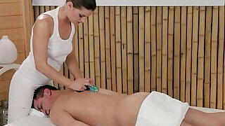 6:00: Masseuse rubs dick with tits and feet on massage table