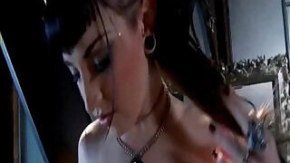 12:00: Gothic suicide babe with pierced nipples and tattoos