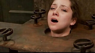 11:00: A sub girl bondaged, throatfucked and a clit tortured