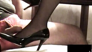 7:00: Black Stocking Footjob with facial Cumshot